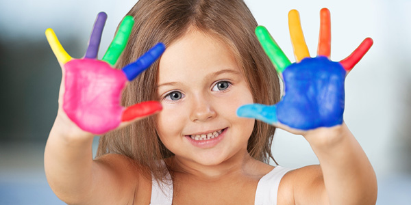 Girl with colorful paint fingers